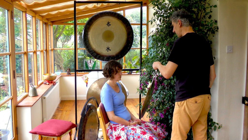 sound healing with gong client sitting